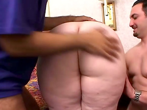 Black-haired fattie Glory Foxxx works on two shafts in the bedroom