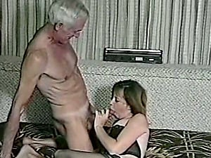 A female in stockings and undergarments has hookup with old man