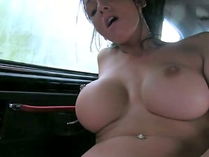 Huge-chested black-haired chick is railing a cab driver's dick