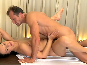 Dark-haired cutie gets her cootchie massaged and fucked in missionary position