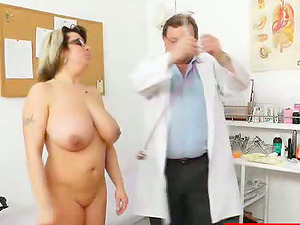 This Cougar has some earnestly big natural tits and it is injection time as she hits the examination table