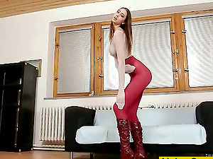Gorgeous Kitty Jane poses in nylon bodysuit and high boots