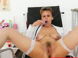Mature Nurse is pumping her shaggy beaver with fucktoy