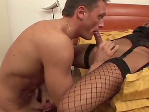 Sizzling tranny in fishnets and a boy fuck each other