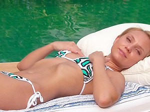 Hot Stunner Frigs Her Labia Next To The Swimming Pool