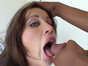 Lovely black-haired Naudia Rio milks a Big black cock dry on her beautiful face