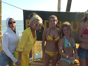 Some whorish femmes flash their tits and butts at an outdoor soiree