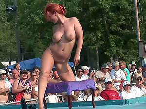 Exhibitionist Redheaded Mummy Dances Naked in Front of a Crowd