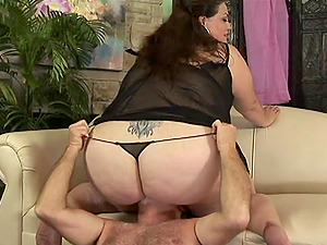 Fat black-haired Angelina deepthroats a prick and welcomes it in her meaty twat