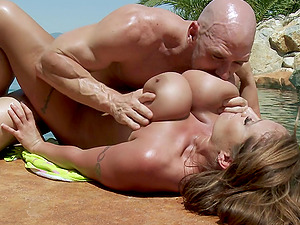 A big titted Cougar hooks up with the pool boy and gets pounded in the pool
