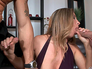Devon Lee is fucked by two guys in a gonzo threesome