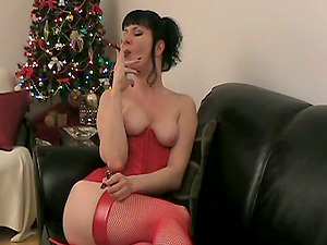 Brown-haired solo model in crimson underwear smoking on the leather couch