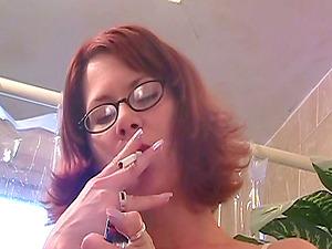 Ginger-haired cougar is filmed having a smoke butt naked