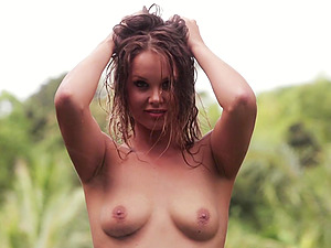 Georgie Gee in panty shows shaven labia and tits in the forest
