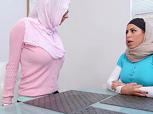 Julianna Vega and Mia Khalifa wearing headscarves share a dick
