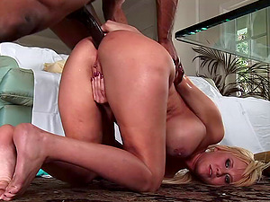 Attractive cowgirl with big tits guzzles jizz in interracial lovemaking