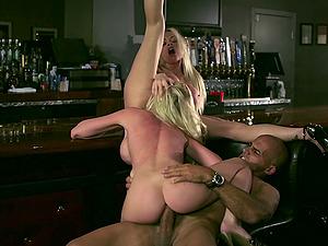 Blonde honies Jesse Jane and Madison Scott share a boner in a bar