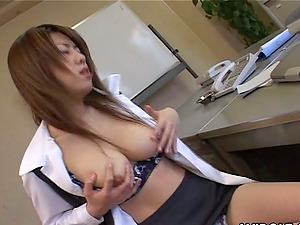 Japanese solo model in fishnet caressing her natural tits