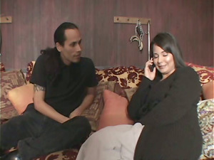 Michelle paws a man's face with her feet in foot worship flick