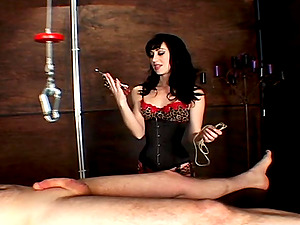 Gorgeous honey with a fetish in stockings providing a ball busting torment to her dude