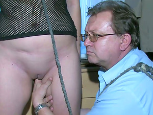 Dark-haired fettered in a pillory has FFM threesome with mature duo