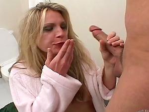 Honey in a bathrobe bangs her man in the cramped bathroom
