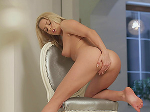 Lusty bellows escape the lips of the masturbating blonde chick