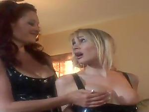 Mistress in shiny spandex joys a damsel with a stimulating fucktoy