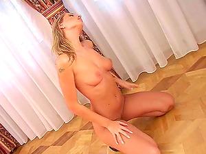 Blonde beauty in high stilettos spreading her gams to flash her twat
