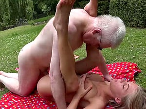 Grandpa lotions up and fucks a bathing suit woman in the grass