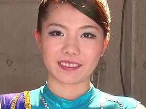 Japanese gymnast in a shiny leotard arches her bod and blows him