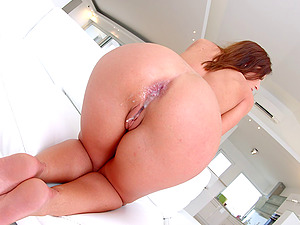 Red-haired is clothed to amaze and does two dicks with her donk