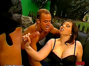 Adorable honey chocks her jaws with jumbo sausages in an erotic threesome romp