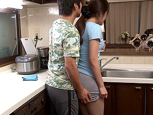 Asian Cougar has her miniskirt lifted and cootchie fucked in the kitchen