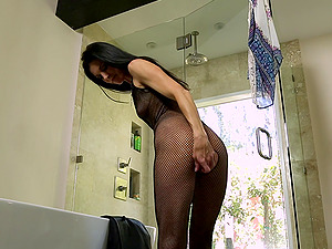 Kinky wifey wears a fishnet bodysuit while providing an erotic rubdown