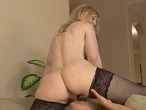Mature lesbo blondes have joy while using a strapon