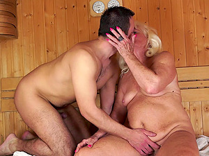 He meets a granny in the sauna and sweats as he fucks her