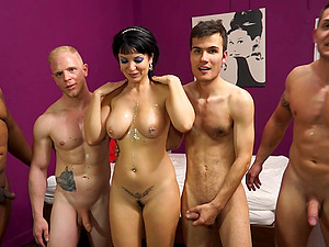 Faux tits fuckslut in sofa for a gang-bang with a group of horny guys