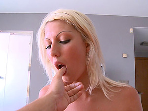Stunning blonde gives an amazing boob fucking to her beloved counterpart