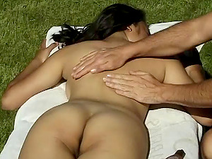 While sunbathing naked this Asian woman gets lotion kneaded on her assets