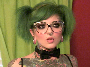 Punk chicks with lots of tattoos have fun behind the scenes
