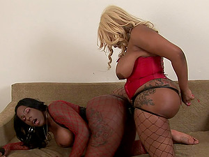 Chubby dark-hued lesbo and her paramour fucking big playthings