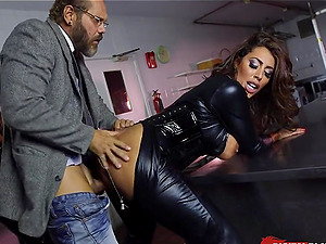 Skintight leather catsuits on sex industry stars using his big dick