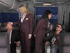 Two stewardesses get fucked by two biz class passengers