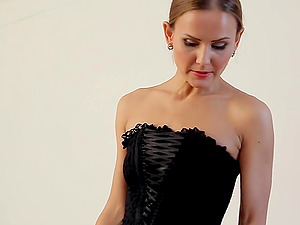Beauty in a corset is revved on by making him suck toes