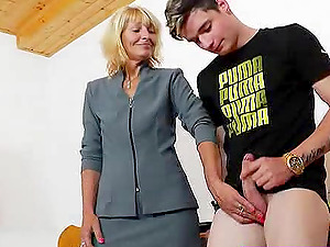 Lucky mature chick is glad to give the gorgeous fellow a nice handjob