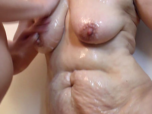 Granny g/g getting oiled in mature pornography shoot