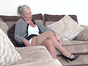 Saucy granny with big saggy tits likes pleasing her tasty muff