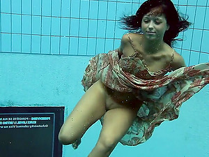 Russian teenage diving while demonstrating off her natural tits