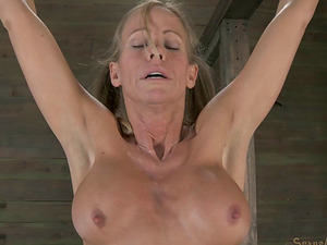 Blonde with ponytails called Simone has to suck the dick while tied up!